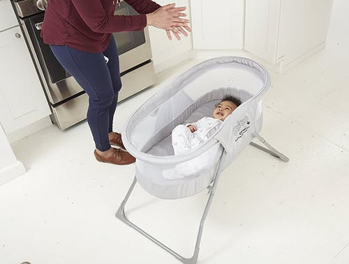 baby sleeping in Primo Cocoon bassinet