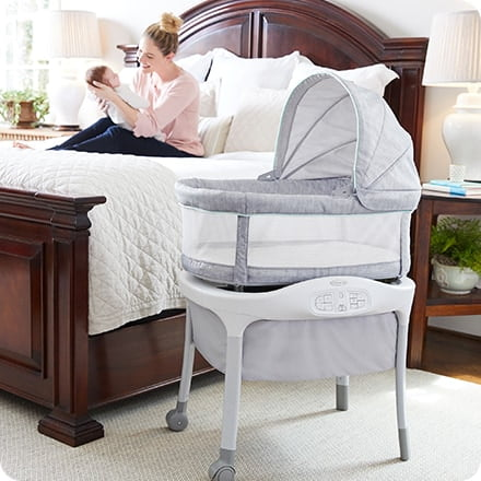 Graco Move And Soothe Bassinet mom holding a baby