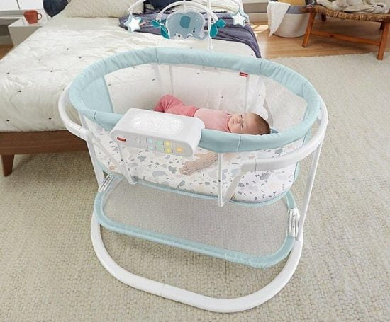 baby sleeping in Fisher-Price Soothing Motions Bassinet