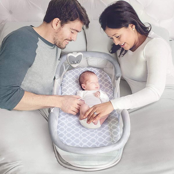 baby sleeping in SwaddleMe by Your Side Sleeper bassinet