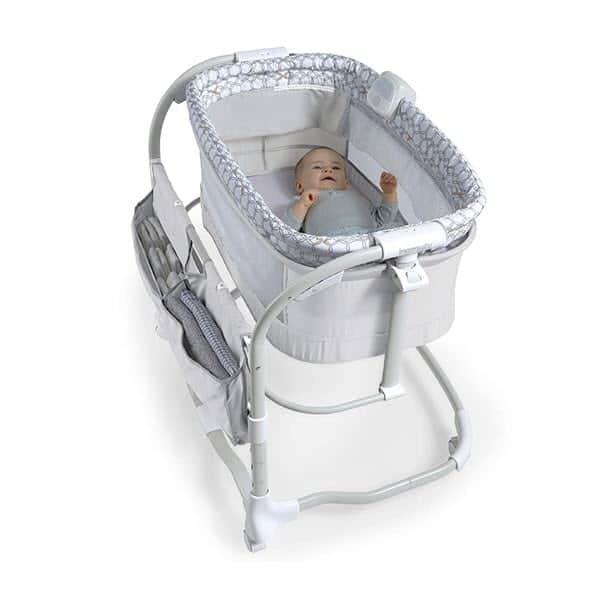 baby sleeping in ingenuity dream & grow bedside bassinet