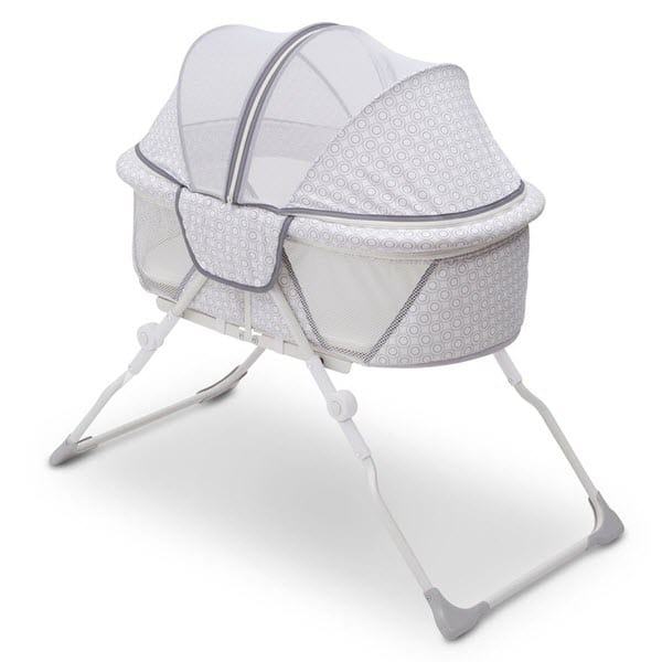 full size canopy of the Delta Children EZ Fold Ultra Compact Travel Bedside Bassinet