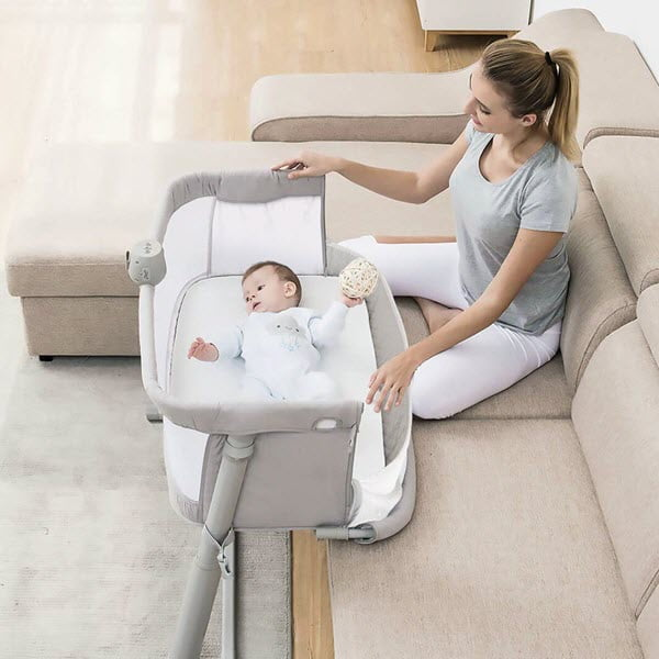 place RONBEI Bedside Sleeper Baby Bed Bassinet near the sofa