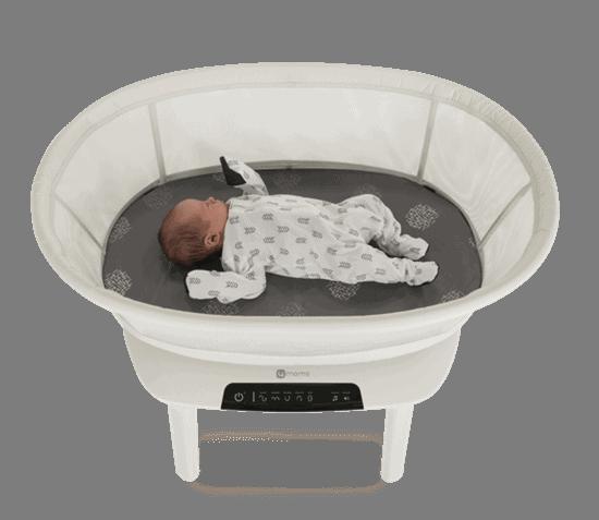baby sleeping in 4moms mamaRoo sleep bassinet