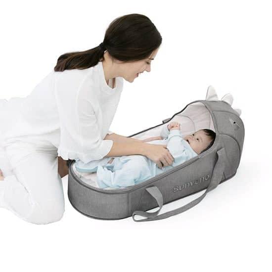 baby sleeping in SUNVENO Moses Basket Bassinet Bedside Sleeper