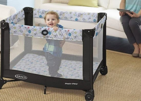 baby standing and pushing pack n play