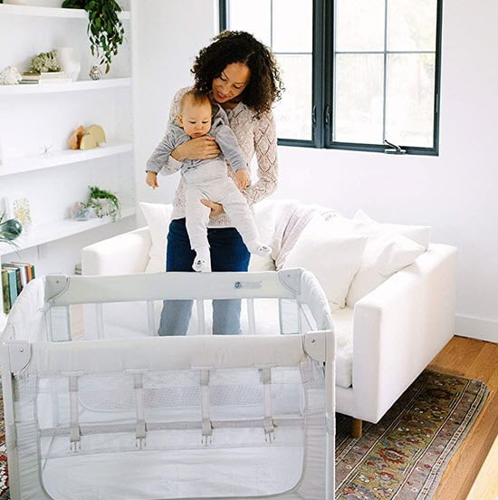 putting baby in Arm's Reach Ideal Ezee 2 in 1 Co-Sleeper Portable Baby Bassinet