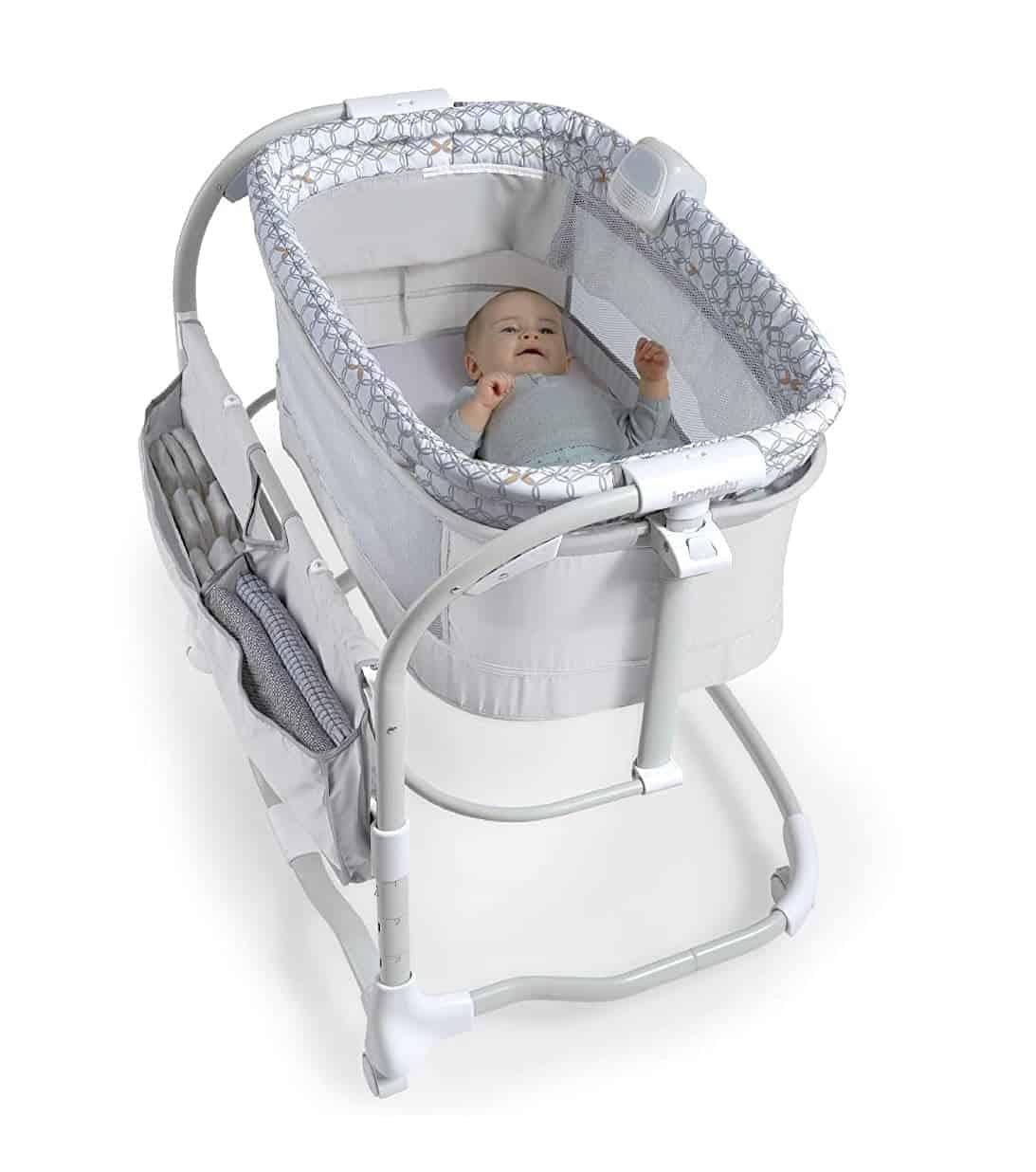 Baby sleeping in Ingenuity Dream and Grow Bedside Bassinet